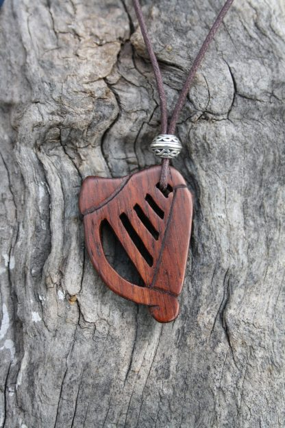 Hand-carved rosewood irish harp necklace